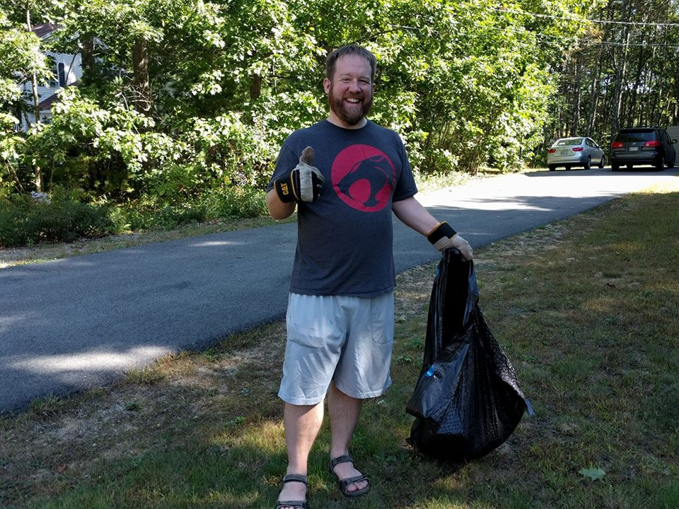 Charles B Hamlyn holding trash bag at Homestead Drive