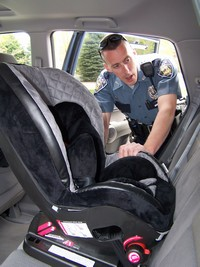 Police Officer performing a child safety seat check